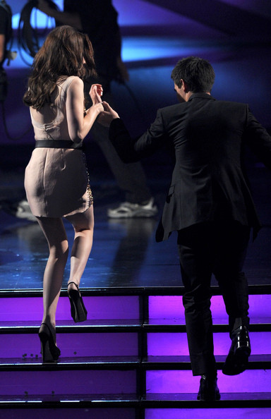 Taylor Lautner Actress Kristen Stewart (L) and Taylor Lautner walk onstage during the 2011 People's Choice Awards at Nokia Theatre L.A. Live on January 5, 2011 in Los Angeles, California.