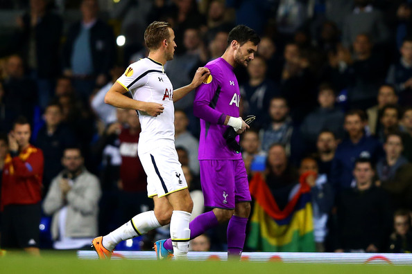Harry Kane of Spurs speaks with team-mate Hugo Lloris as he volunteers to go in goal following Lloris' sending off during the UEFA Europa League group C match between Tottenham Hotspur FC and Asteras Tripolis FC at White Hart Lane on October 23, 2014 in London, United Kingdom.
