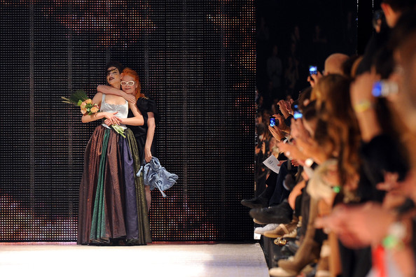Vivienne Westwood (R) poses with a model on the runway during the Vivienne Westwood Ready to Wear Spring/Summer 2011 show during Paris Fashion Week on October 1, 2010 in Paris, France.