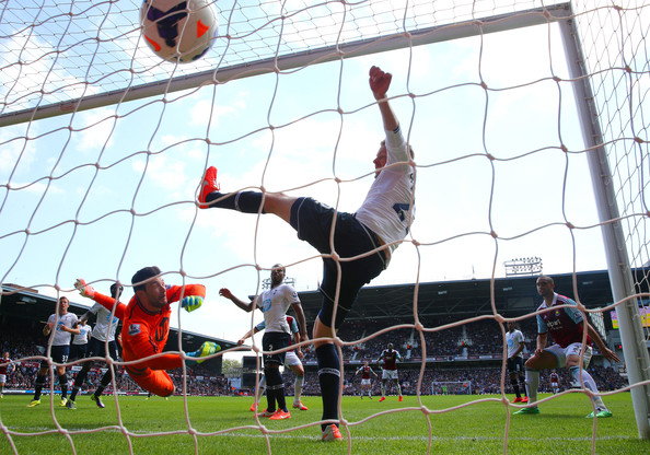 (L-R) Goalkeeper Hugo Lloris of Spurs and Gylfi Sigurdsson of Spurs fail to stop the ball going into the net as teamate Harry Kane (L) of Spurs scores an own goal during the Barclays Premier League match between West Ham United and Tottenham Hotspur at Boleyn Ground on May 3, 2014 in London, England.