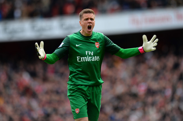 Wojciech Szczesny Wojciech Szczesny of Arsenal celebrates after Theo Walcott of Arsenal scores the opening goal during the Barclays Premier League match between Arsenal and Manchester United at Emirates Stadium on April 28, 2013 in London, England.