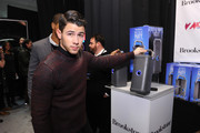 Singer Nick Jonas attends the Z100's Artist Gift Lounge presented by Goldfish Puffs at Z100's Jingle Ball 2014 at Madison Square Garden on December 12, 2014 in New York City.
