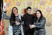Singer Nick Jonas (C) attends the Z100's Artist Gift Lounge presented by Goldfish Puffs at Z100's Jingle Ball 2014 at Madison Square Garden on December 12, 2014 in New York City.
