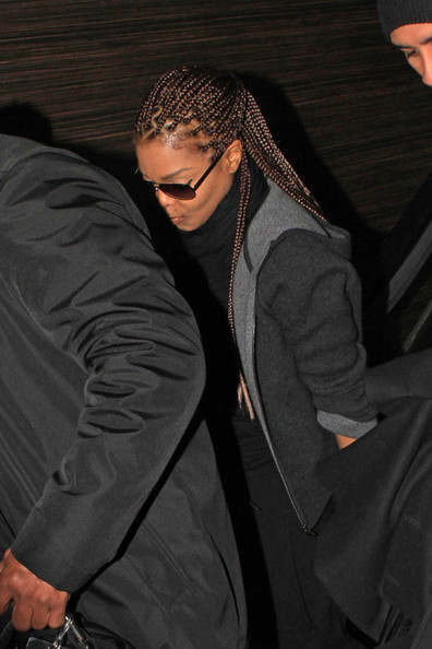 Janet Jackson is flanked by her security team as she heads out of LAX.