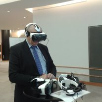 MEP Charles Goerens watching UNFPA VR movie Photo: UN Brussels