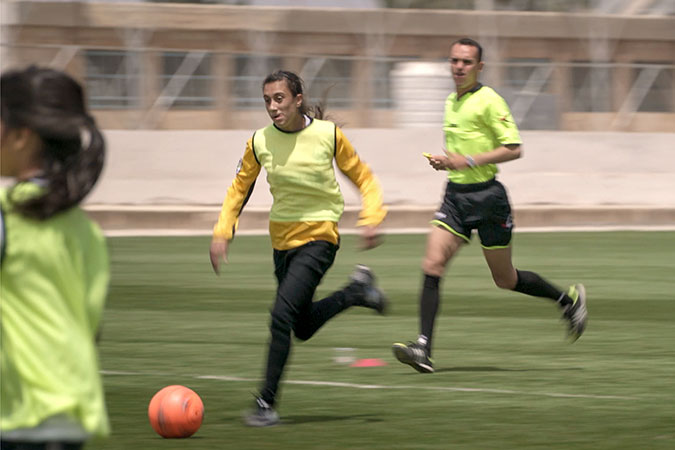 Syrian refugees and Jordanians play football together in Jordan. Photo: UN Women/Christopher Herwig