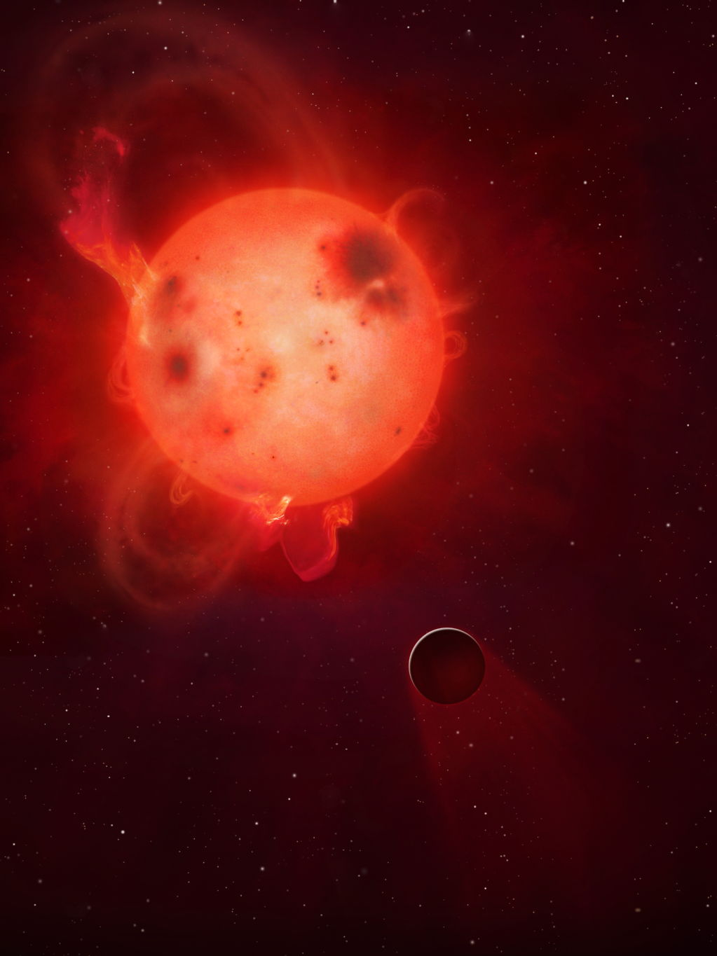 Image caption: Kepler-438b: The planet Kepler-438b is shown here in front of its violent parent star. It is regularly irradiated by huge flares of radiation, which could render the planet uninhabitable. Here the planet's atmosphere is shown being stripped away.