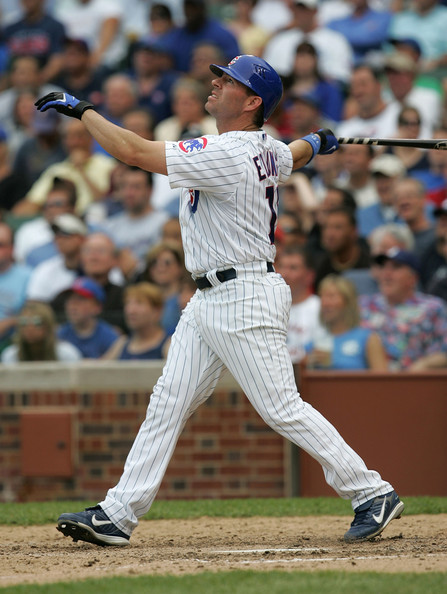 Jim Edmonds #15 of the Chicago Cubs watches the flight of his first home run as a member of the Cubs, a solo shot in the 6th inning, against the Colorado Rockies on May 30, 2008 at Wrigley Field in Chicago, Illinois. The Cubs defeated the Rockies 10-9.