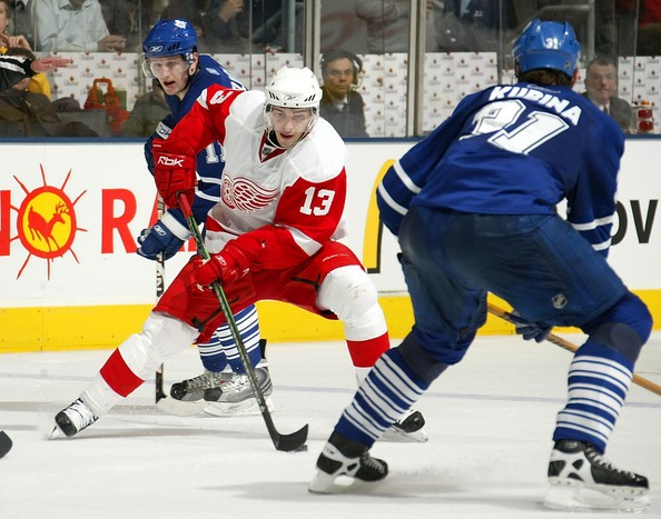 Pavel Datsyuk Pavel Kubina #31 of the Toronto Maple Leafs defends against Pavel Datsyuk #13 of the Detroit Red Wings during their NHL game at the Air Canada Centre February 9, 2008 in Toronto, Ontario.
