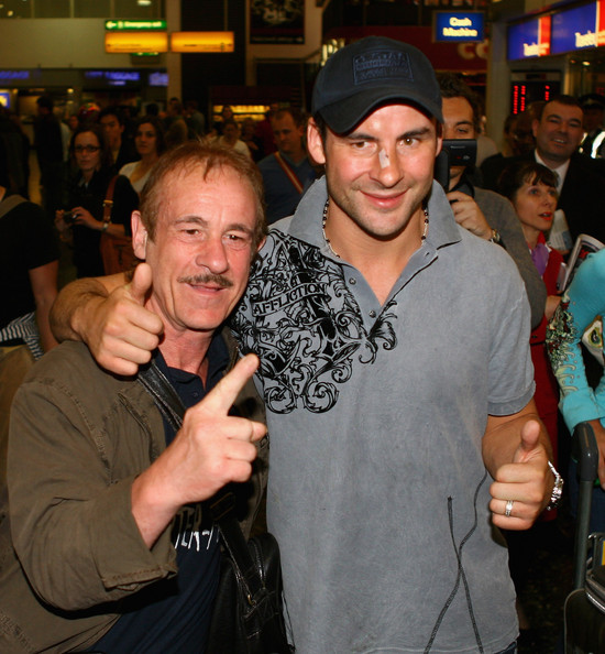 Joe Calzaghe of Wales (R) poses with his father Enzo as they arrive back from Las Vegas, Nevada pictured at Gatwick airport after victory against Bernard Hopkins for the light heavyweight bout on April 21, 2008 in Gatwick, England.