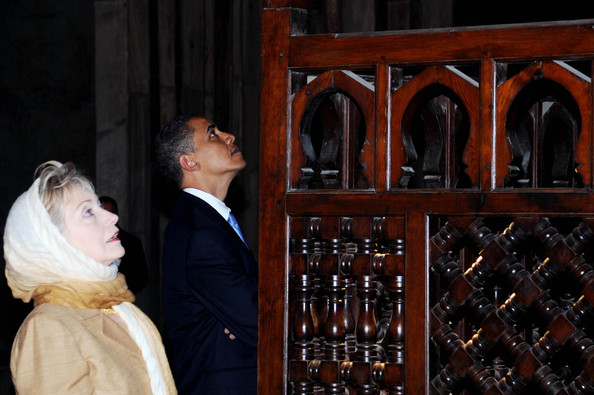 "US President Barack Obama and his Secretary of State Hillary Clinton visit the Sultan Hassan mosque before making his key Middle East policy speech on June 4, 2009 in Cairo, Egypt.  Obama called for a ""new beginning between the United States and Muslims"", declaring that ""this cycle of suspicion and discord must end"". (Photo by Sameh Refaat - Pool/MENA/Getty Images) *** Local Caption *** Barack Obama;Hillary Clinton"