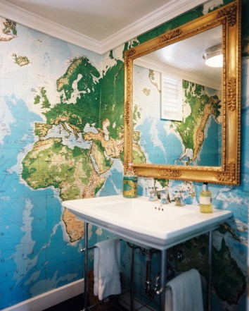 Wallpaper Designs Bathroom with World Map Wallpaper and Gold Mirror