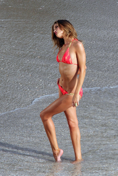 British model Rosie Huntington-Whiteley poses for a Victoria's Secret catalogue photo shoot on the beach.