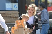 Singer and actress Hilary Duff stops by Ralph's in Studio City, California to stock up on groceries with her son Luca on February 19, 2015. Hilary couldn't help but laugh at her son who kept picking his nose in front of the photographers!