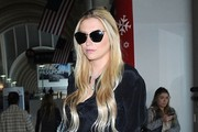 Singer Kesha departing on a flight at LAX airport in Los Angeles, California on December 20, 2014. Kesha looked to be in good spirits despite filing a sexual assault and battery lawsuit against her producer a couple of months ago.