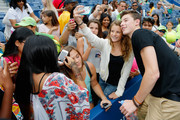 Shawn Mendes, musical artist, poses for a 'selfie' with a fan before the stadium show during Arthur Ashe Kids' Day prior to the start of the 2014 U.S. Open at the USTA Billie Jean King National Tennis Center on August 23, 2014 in the Flushing neighborhood of Queens in New York City.