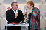 Radio personality Elvis Duran (L) and recording artist Ed Sheeran attend the 2014 iHeartRadio Music Festival at the MGM Grand Garden Arena on September 20, 2014 in Las Vegas, Nevada.