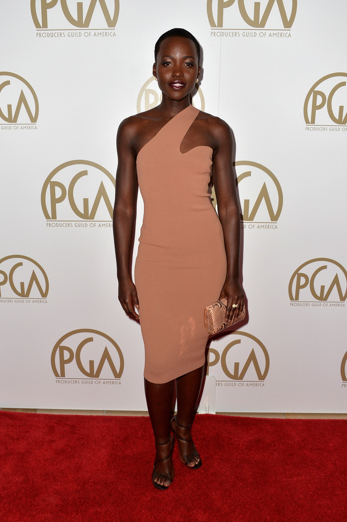 lupita nyongo'o in a nude flesh tone one shoulder dress