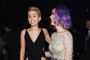 inger-songwriters Miley Cyrus (L) and Katy Perry attend The 57th Annual GRAMMY Awards at the STAPLES Center on February 8, 2015 in Los Angeles, California.