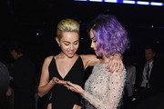 Recording Artists Miley Cyrus and Katy Perry attend The 57th Annual GRAMMY Awards at the STAPLES Center on February 8, 2015 in Los Angeles, California.
