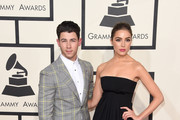 Musician Nick Jonas (L) and model Olivia Culpo attend The 57th Annual GRAMMY Awards at the STAPLES Center on February 8, 2015 in Los Angeles, California.