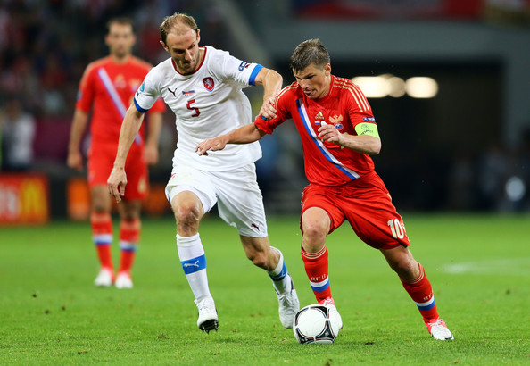 Andrey Arshavin Andrey Arshavin of Russia and  Roman Hubník of Czech Republic fight for the ball during the UEFA EURO 2012 group A match between Russia and Czech Republic at The Municipal Stadium on June 8, 2012 in Wroclaw, Poland.