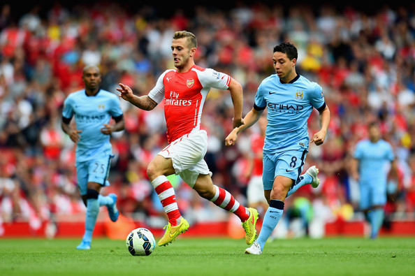 Samir Nasri of Manchester City pursues Jack Wilshere of Arsenal during the Barclays Premier League match between Arsenal and Manchester City at Emirates Stadium on September 13, 2014 in London, England.