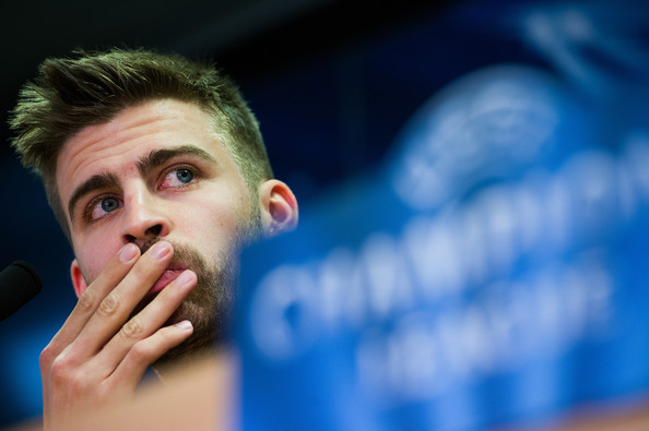 Gerard Pique of FC Barcelona faces the media during a press conference ahead of their UEFA Champions League round of 16 second leg against AC Milan at the Joan Gamper Sport Complex on March 11, 2013 in Barcelona, Spain.