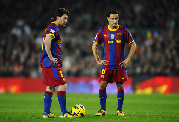 Lionel Messi of FC Barcelona (L) and his teammate Xavi Hernandez look on during the La Liga match between Barcelona and Villarreal CF at Camp Nou Stadium on November 13, 2010 in Barcelona, Spain. Barcelona won the match 3-1.