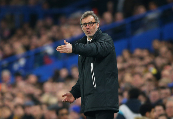 Laurent Blanc the head coach of PSG directs his players during the UEFA Champions League Round of 16, second leg match between Chelsea and Paris Saint-Germain at Stamford Bridge on March 11, 2015 in London, England.