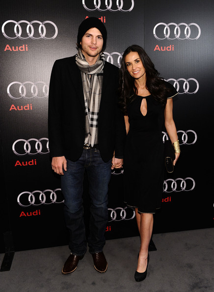 Actor Ashton Kutcher (L) and actress Demi Moore attend the Super Bowl 2011