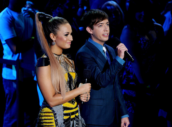 Demi Lovato Hosts Demi Lovato (L) and Kevin McHale speak onstage during the 2012 Teen Choice Awards at Gibson Amphitheatre on July 22, 2012 in Universal City, California.