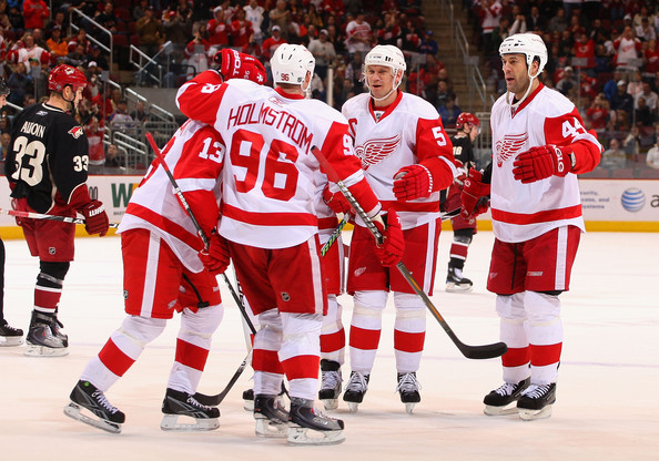 Tomas Holmstrom #96 of the Detroit Red Wings celebrates with teammates Pavel Datsyuk #13, Nicklas Lidstrom #5 and Todd Bertuzzi #44 after Holmstrom scored a second period goal against the Phoenix Coyotes during the NHL game at Jobing.com Arena on January 2, 2010 in Glendale, Arizona.