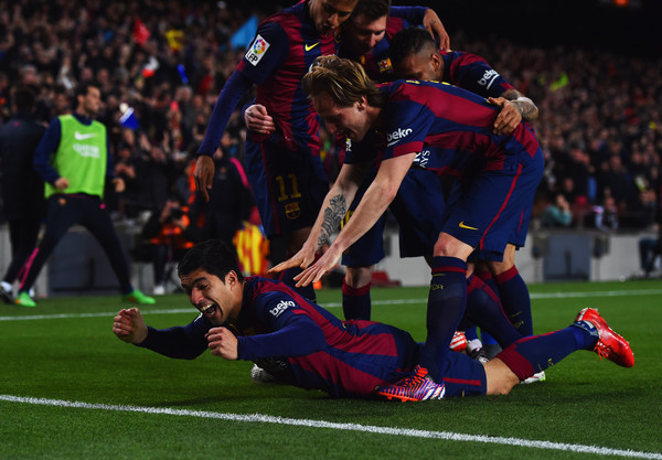 Luis Suarez of Barcelona (grounded) celebrates with team mates as he scores their second goal during the La Liga match between FC Barcelona and Real Madrid CF at Camp Nou on March 22, 2015 in Barcelona, Spain.