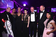 (L-R) Singer/songwriter Miley Cyrus, Marianne Freda,  Global Brand President, MAC Cosmetics, Karen Buglisi Weiler, performer Dita Von Teese, CEO of Estee Lauder, Fabrizio Freda, Group President of the Estee Lauder Companies, John Demsey and rapper Lil' Kim attend the 23rd Annual Elton John AIDS Foundation Academy Awards Viewing Party on February 22, 2015 in Los Angeles, California.