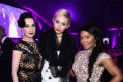 (L-R) Model Dita Von Teese and recording artists Miley Cyrus and Lil' Kim attend the 23rd Annual Elton John AIDS Foundation Academy Awards Viewing Party on February 22, 2015 in Los Angeles, California.
