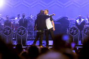 Jay-Z (L) and musician Justin Timberlake appear on stage at Barclays Center on December 14, 2014 in the Brooklyn borough of New York City.