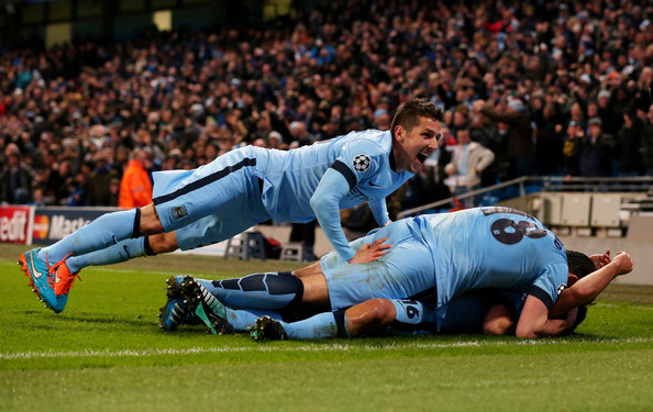 Sergio Aguero #16 (on ground) of Manchester City celebrates with teammate Stevan Jovetic (L) and Frank Lampard #18 after scoring his team's third and matchwinning goal during the UEFA Champions League Group E match between Manchester City and FC Bayern Muenchen at the Etihad Stadium on November 25, 2014 in Manchester, United Kingdom.