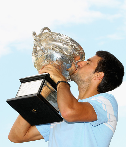 Novak Djokovic Novak Djokovic of Serbia poses with the Norman Brookes Challenge Cup at the Melbourne Cricket Ground on January 31, 2011 in Melbourne, Australia.