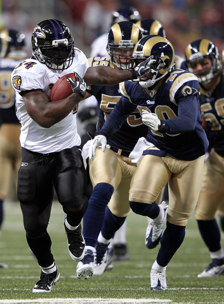 Ricky Williams Ricky Williams #34 of the Baltimore Ravens carries the ball as Darian Stewart #20 of the St. Louis Rams chases during the game on September 25, 2011 at the Edward Jones Dome in St Louis, Missouri.