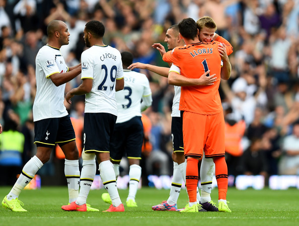 Matchwinning goalscorer Eric Dier (R) of Spurs is congratulated by teammate Hugo Lloris following their team's 1-0 victory during the Barclays Premier League match between West Ham United and Tottenham Hotspur at Boleyn Ground on August 16, 2014 in London, England.