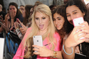 Singer/songwriter Meghan Trainor poses with fans at Y100's Jingle Ball Village, Y100's Jingle Ball 2014 official pre-show at BB&T Center on December 21, 2014 in Miami, FL.