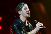 Nick Jonas performs onstage during Y100's Jingle Ball 2014 at BB&T Center on December 21, 2014 in Miami, FL.