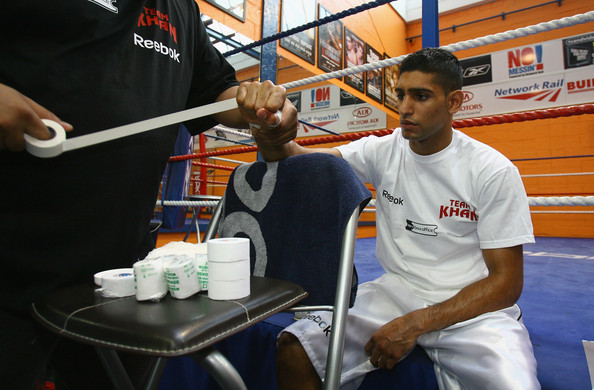 Amir Khan gets his hands taped up prior to a media workout at the Gloves Community Centre on March 6, 2009 in Bolton, England. Amir Khan is due to fight Marco Antonio Barrera of Mexico at the MEN Arena on March 14, 2009 in Manchester, England.  (Photo by Alex Livesey/Getty Images) *** Local Caption *** Amir Khan