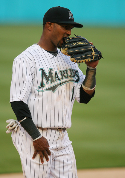 Emilio Bonifacio Emilio Bonifacio #1 of the Florida Marlins chews on his glove in between pitches while taking on the Washington Nationals on opening day at Dolphin Stadium on April 6, 2009 in Miami, Florida. The Marlins defeated the Nationals 12-5.  (Photo by Doug Benc/Getty Images) *** Local Caption *** Emilio Bonifacio