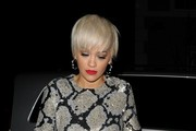 Rita Ora resembles 60's fashion model Twiggy with her hair in a pixie cut while wearing a snake skin mini dress with silver platform shoes as she arrives home after filming The Graham Norton Show at ITV studios.