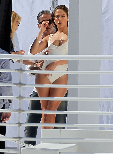 """American Idol"" judge Jennifer Lopez sporting a white one piece swimsuit during a photo shoot in Miami, FL on January 27, 2012. Jennifer's super young boyfriend Casper Smart was on set and gave his girl a kiss on the forehead and shoulder"