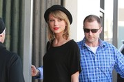 """Singer Taylor Swift stops by a studio in Hollywood, California on February 4, 2015. Taylor recently revealed that she won't perform at this year's Grammy Awards saying, """"Since my whole life is wrapped up and entangled in the planning of The 1989 World Tour right now, I'm not going to be performing on the Grammys this year. I need this time to focus only on the tour."""""""