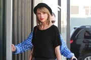 "Singer Taylor Swift stops by a studio in Hollywood, California on February 4, 2015. Taylor recently revealed that she won't perform at this year's Grammy Awards saying, ""Since my whole life is wrapped up and entangled in the planning of The 1989 World Tour right now, I'm not going to be performing on the Grammys this year. I need this time to focus only on the tour."""