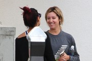 Former 'High School Music' co-stars and gal pals Ashley Tisdale and Vanessa Hudgens stop to chat after their workouts in Studio City, California on October 16, 2014. Vanessa had her recently dyed red hair, tied up in a bun.